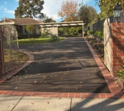 Brick Feature Asphalt Driveway and Gates